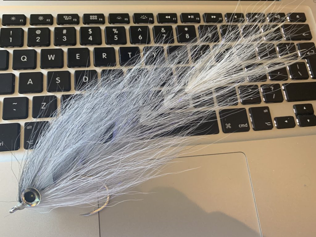 Grey Ghost Version - This one with 8 fine white hackles tied in to the tail section.