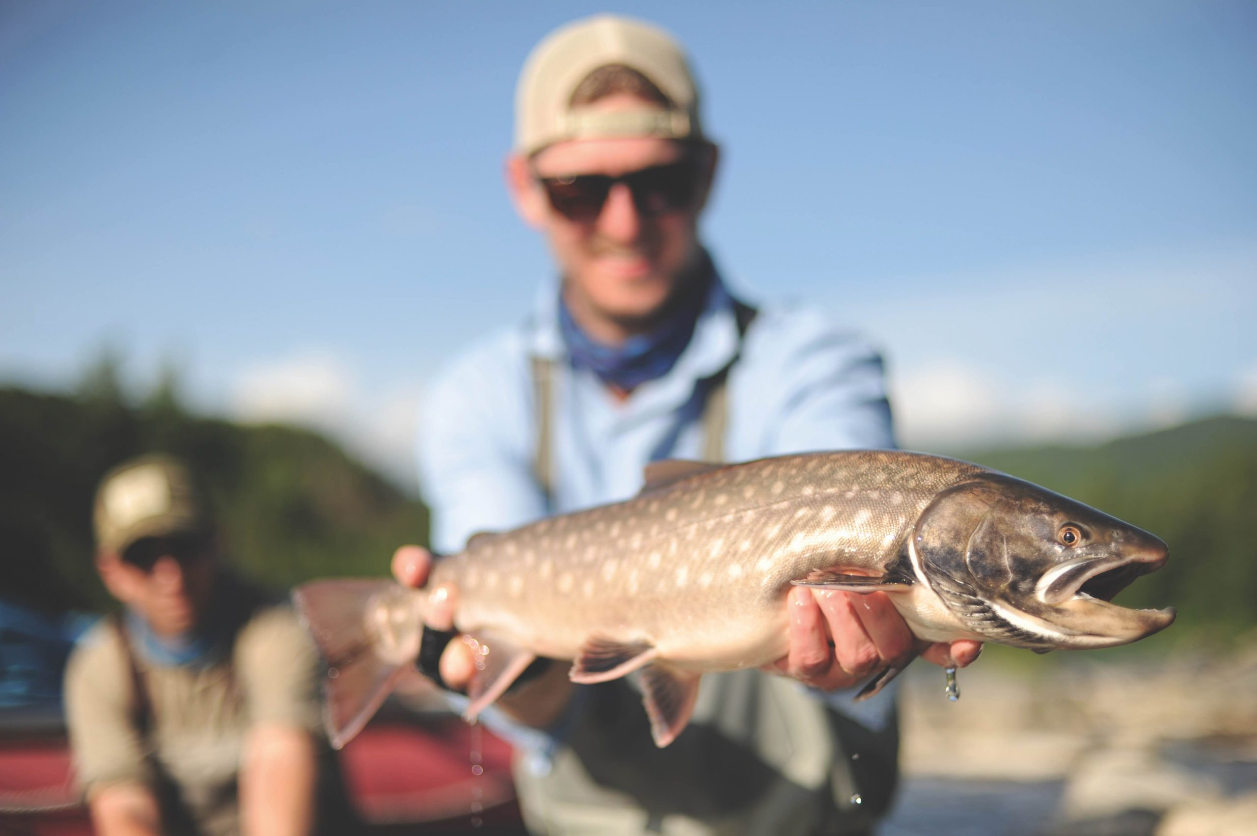 Dean Oelschig with a Siberian white-spotted char