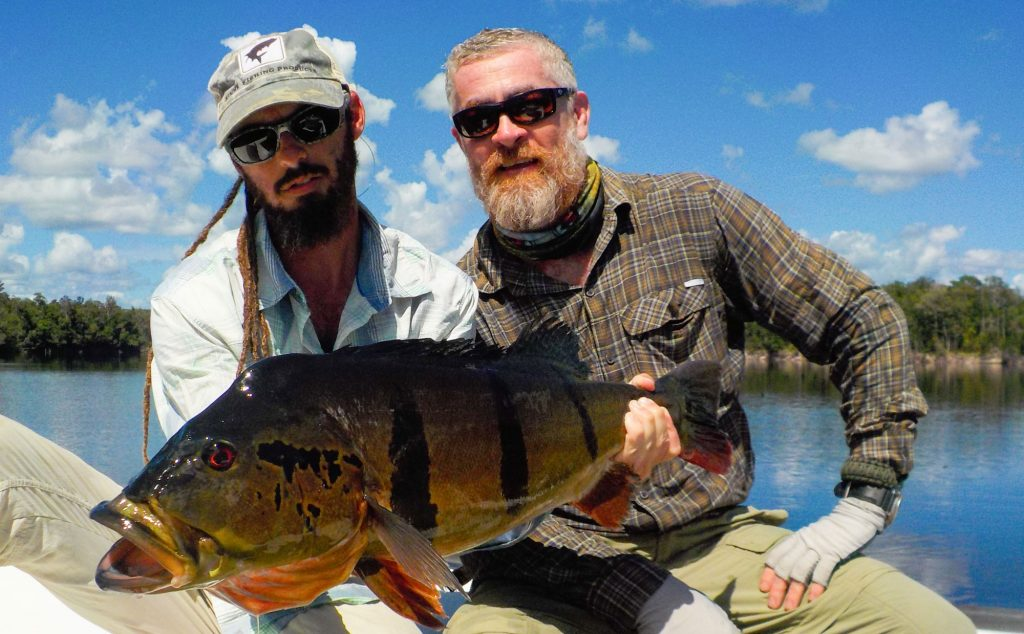 Guide Pablo Callo and Alex Atala with a peacock bass caught at Rio Marie