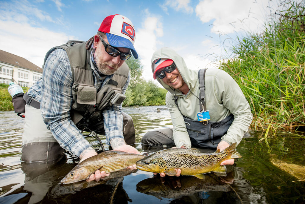 Matthias Strothotte and Paulo Hoffmann with an urban grayling and brown trout respectively. Photo Stephan Dombaj