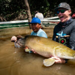 Jako Lucas with an arapaima