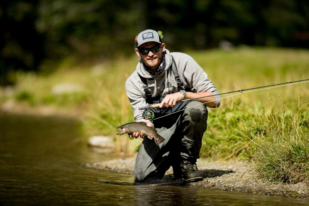 Stephan Dombaj with a brook trout