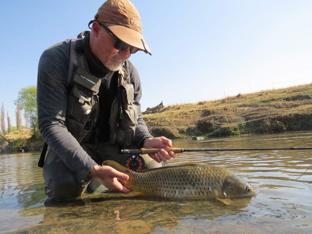 Herman Botes with a carp caught on the Douglas Sky G rod. Photo Pierre Joubert