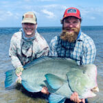 Brendan Becker (right) with client L Mark Weeks and his world record bumpie.