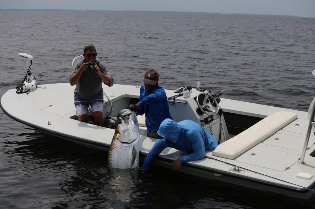 Arno Matthee, happy clients and a mammoth tarpon caught in Gabon