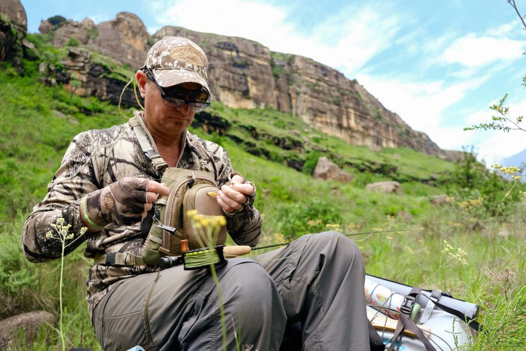 Shaun Futter ties on a heavily weighted nymph on the Injasuti river