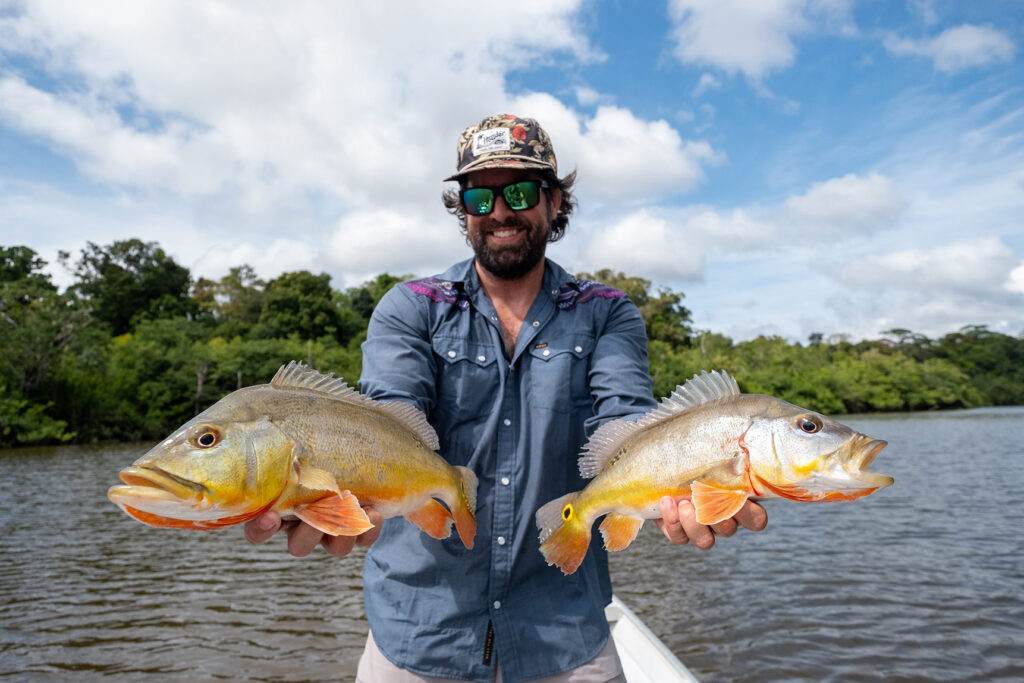 Jay Epping with two peacock bass caught at Rewa Eco Lodge, Guyana.